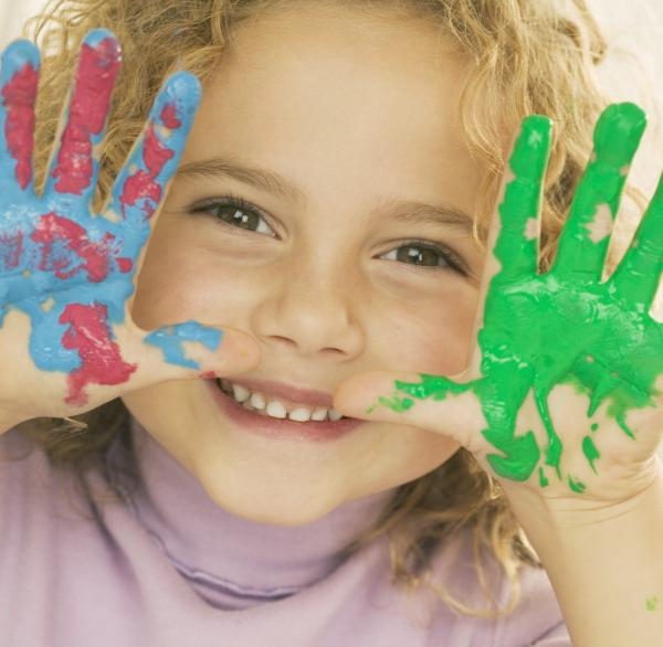 Smiling Girl with Hands Covered in Paint — Image by © Royalty-Free/Corbis