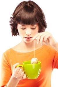young-woman-making-a-cup-of-green-tea